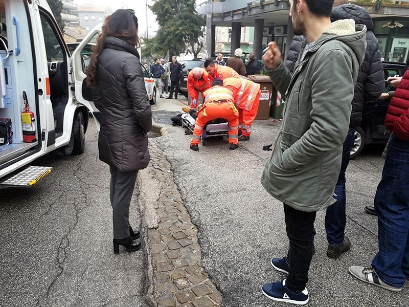 Paramedics treat an injured person that was shot from a passing vehicle in Macerata, Italy, Feb. 03, 2018. (EPA Photo)