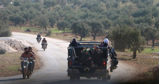 Syrians families flee to safer areas after air strikes in Syria's Idlib. AA Photo