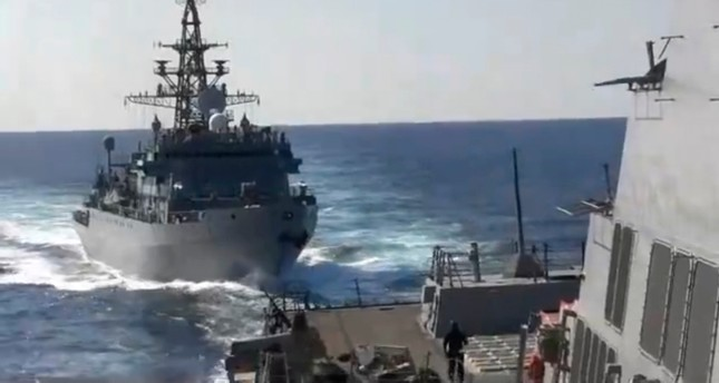 This photo provided bythe U.S. 5th Fleet, shows a Russian Navy ship approaching an American warship in the North Arabian Sea, on Thursday, Jan. 9, 2020. U.S. 5th Fleet via AP