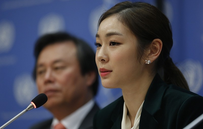 South Korea's 2010 Olympic gold medalist figure skater Yuna Kim, right, speaks during a press conference, Monday Nov. 13, 2017 at U.N. headquarters. (AP Photo)