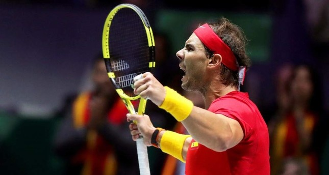 Nadal reacts during his match against Canada's Shapovalov at the finals in Madrid, Nov. 24, 2019. EPA Photo