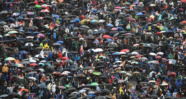 Umbrellas are up in the crowd as rain stops play during the 2019 Cricket World Cup group stage match between India and Pakistan at Old Trafford in Manchester, north-west England, on June 16, 2019. (AFP Photo)