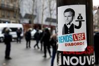Macron says social media, TV 'a poison for democracy'