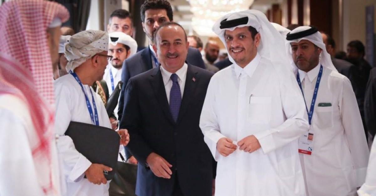 Turkish Foreign Minister Mevlut Cavusoglu (L) and his Qatari counterpart Sheikh Mohammed bin Abdulrahman al-Thani (R) at the Doha Forum, in Doha, Dec. 15, 2019. (AA Photo)