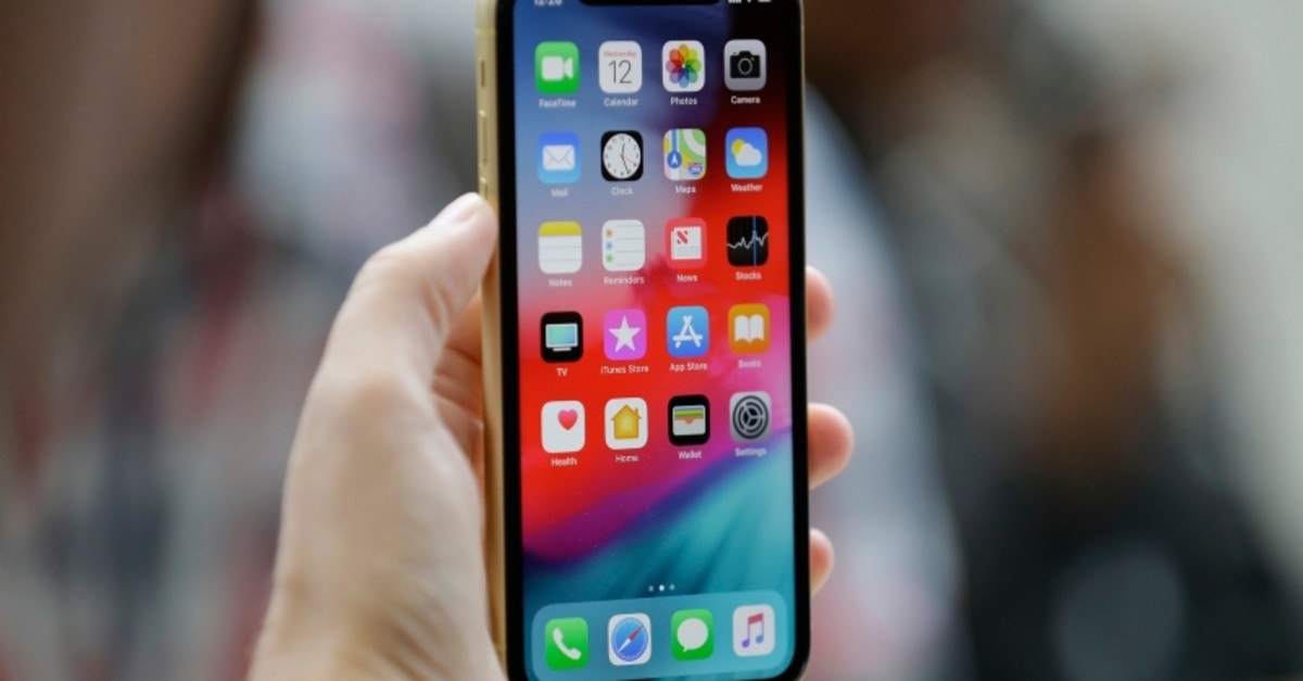 This Sept. 12, 2018, file photo shows an Apple iPhone XR on display at the Steve Jobs Theater after an event to announce new products, in Cupertino, Calif. (AP Photo)