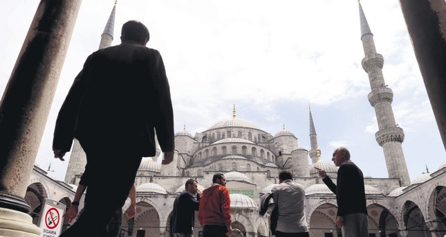 People arriving at the Sultanahmet Mosque in Istanbul for Friday prayers before the Muslim holy month of Ramadan starts, May 26.