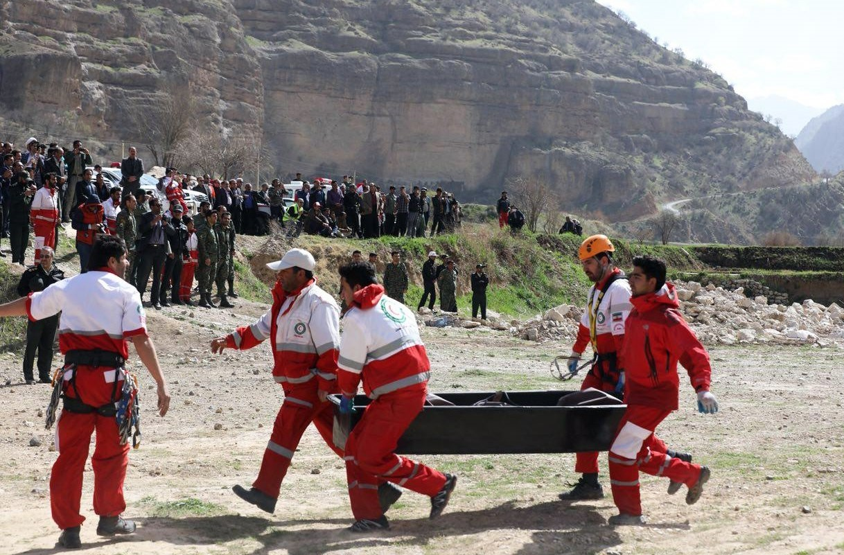 Red Crescent workers carry the body of a victim from the plane crash site. All victims were friends of Mina Bau015faran (R) who hosted a bachelorette party in Dubai ahead of her wedding in April.