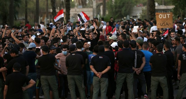 Iraqi security forces stand guard during a protest at Tahrir square in Baghdad, Iraq July 27, 2018. (REUTERS Photo)
