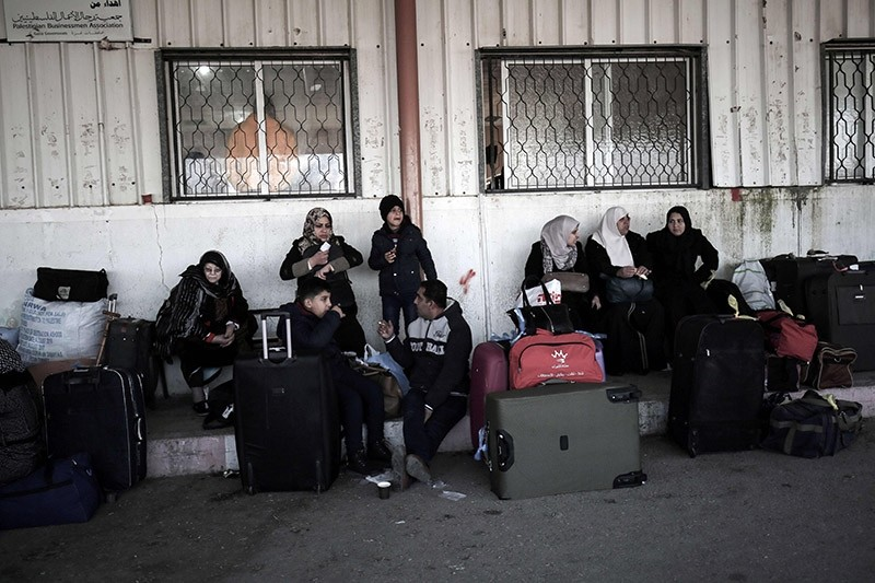 Palestinians wait for travel permits to cross into Egypt through the Rafah border crossing after it was opened by Egyptian authorities for humanitarian cases on February 11, 2017. (AFP Photo)