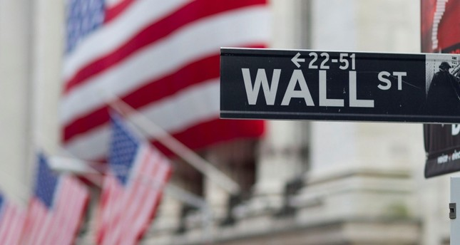 In this Aug. 8. 2011 file photo, a Wall Street sign hangs near the New York Stock Exchange, in New York. (AP Photo)