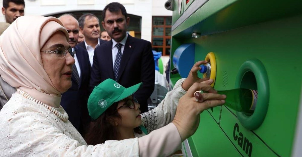 First Lady Emine Erdo?an, who launched the project in 2017, deposits a bottle to a zero waste container, Ankara, Oct. 7, 2019 (AA Photo)