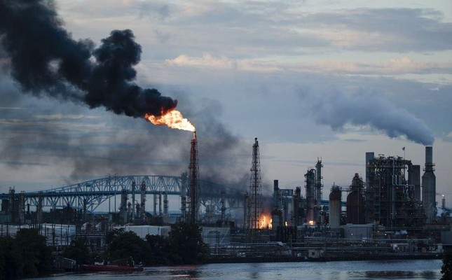 In this June 21, 2019 file photo, flames and smoke emerge from the Philadelphia Energy Solutions Refining Complex in Philadelphia. (AP Photo)
