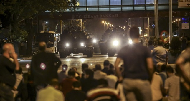 People block a road as tanks controlled by putschists advance in the capital Ankara, Jul.15, 2016.