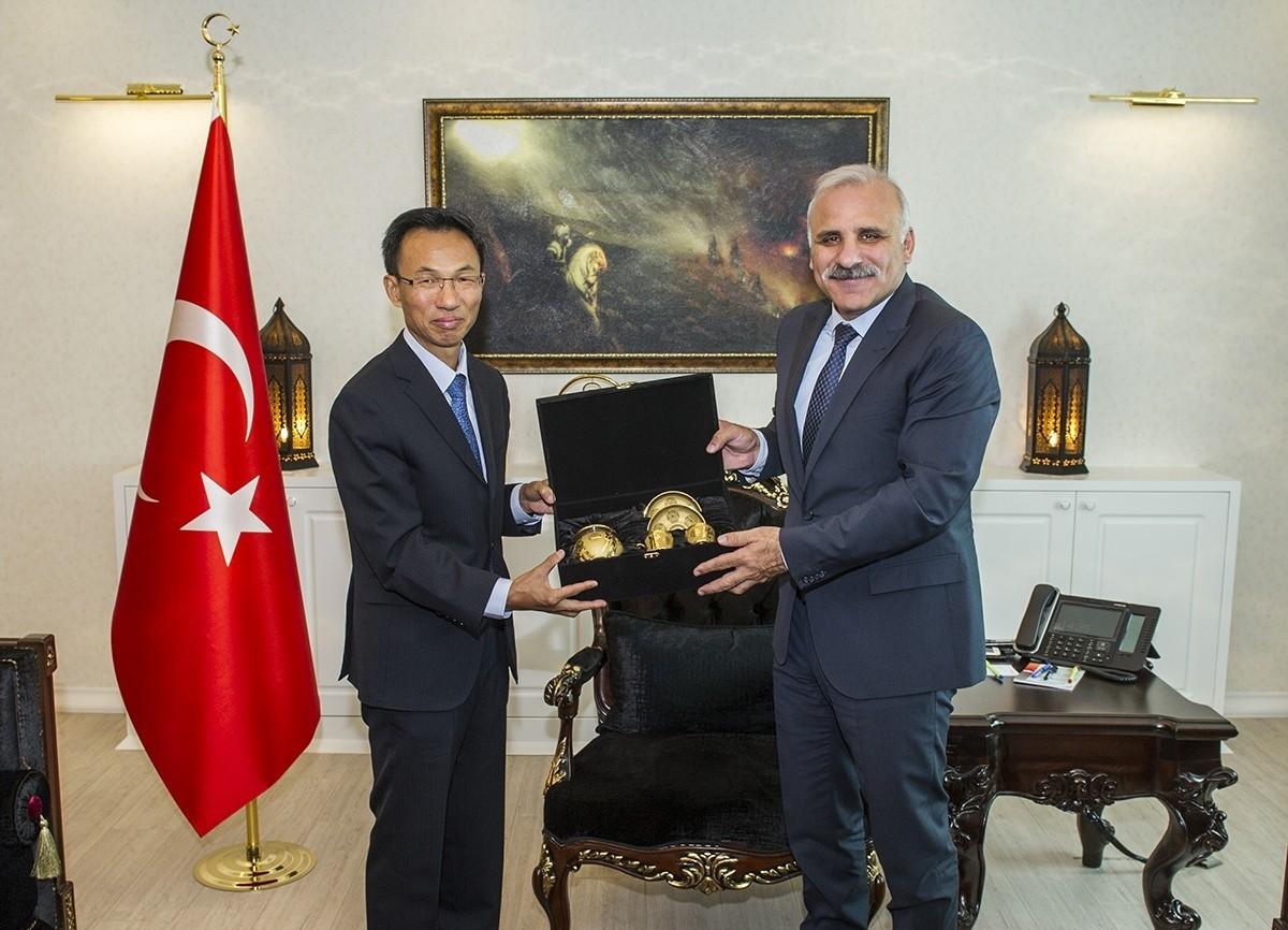 Chinese Ambassador to Ankara Yu Hongyang (L) with Van Governor Murat Zorluou011flu.