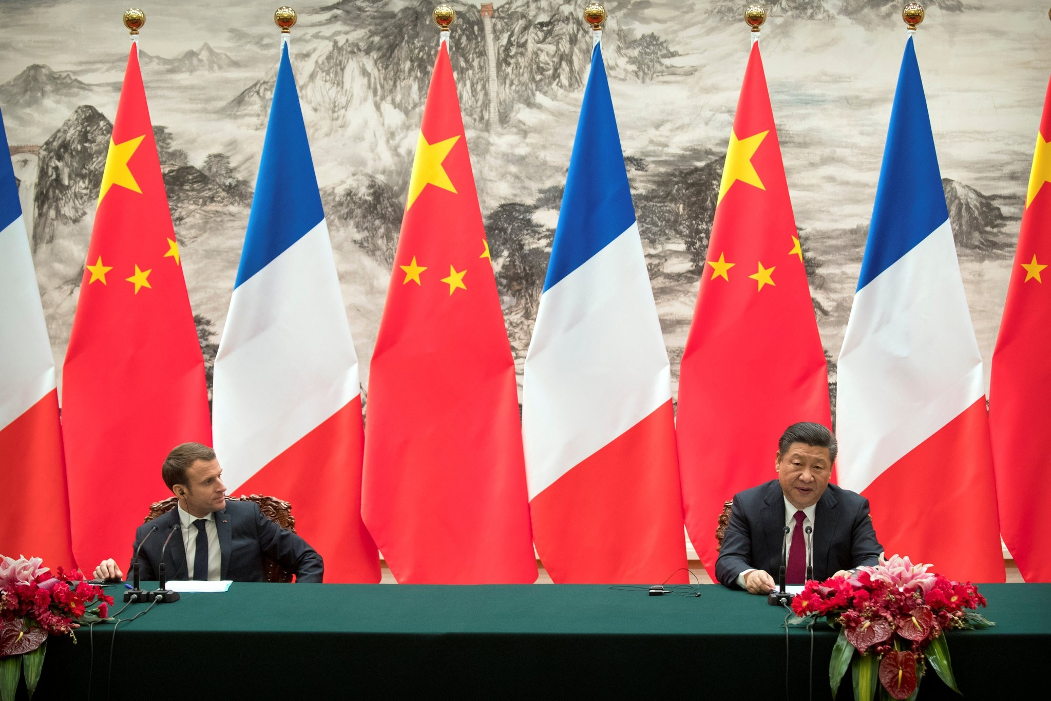 French President Emmanuel Macron, left, listens as Chinese President Xi Jinping speaks during a joint press briefing at the Great Hall of the People in Beijing, China January 9, 2018. (REUTERS Photo)