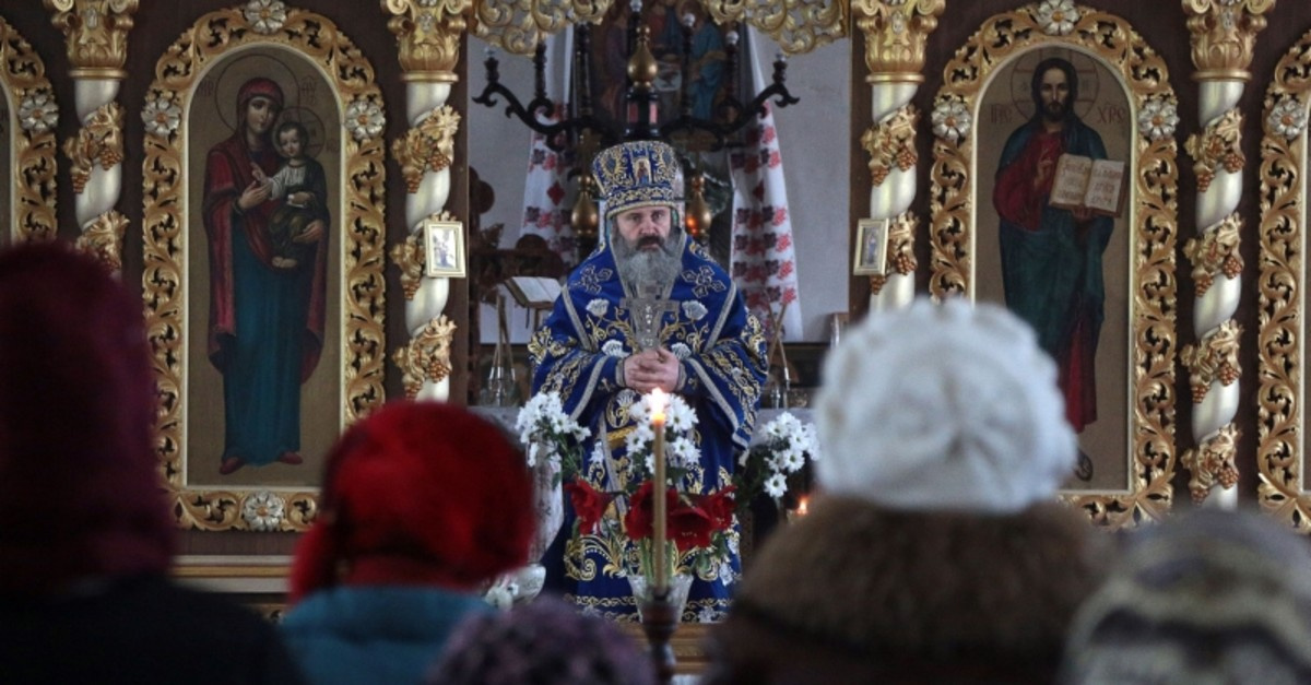 In this file photo taken on Feb. 15, 2019 Father Kliment, the head of the Cathedral of Saint Vladimir and Saint Olga in Simferopol, leads a service. (AFP Photo)