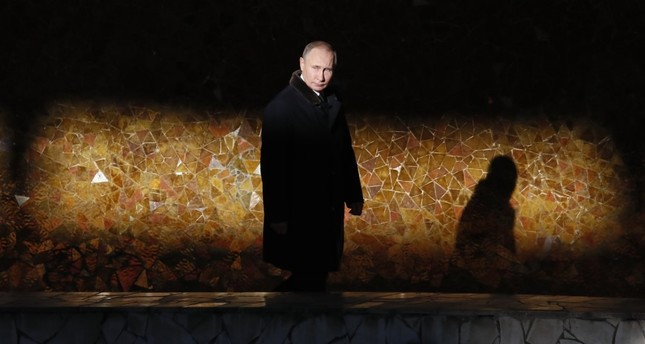 Russian President Vladimir Putin attends a wreath laying ceremony at the Eternal Flame during an event to commemorate the 75th anniversary of the Battle of Stalingrad in World War ıı in Volgograd, Russia Feb. 2.