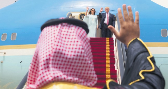 U.S. President Donald Trump and first lady Melania Trump wave to Saudi officials as they board Air Force One before leaving Riyadh for Israel, May 22, 2017.