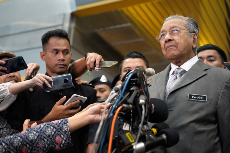 Malaysia's Prime Minister Mahathir Mohamad, right, speaks to the media after a private event in Putrajaya, Malaysia, Monday, Jan. 28, 2019. (AP Photo)