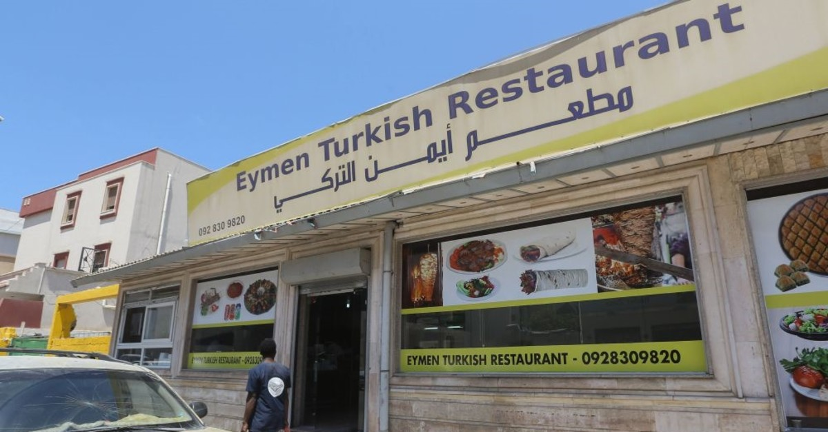 A Libyan man walks past a Turkish restaurant in Tripoli, June 30, 2019.