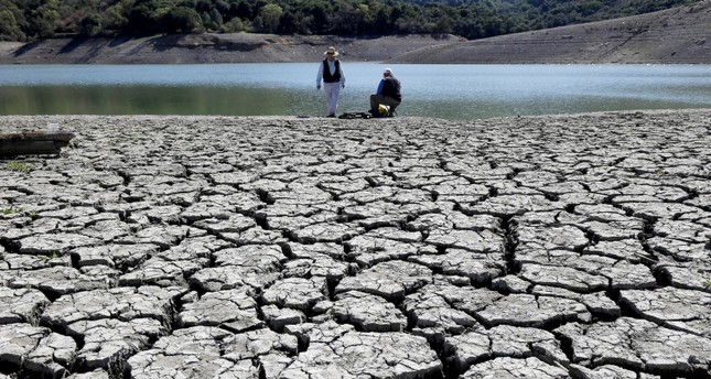This March 13, 2014 file photo shows cracks in the dry bed of the Stevens Creek Reservoir in Cupertino, Calif. (AP Photo)