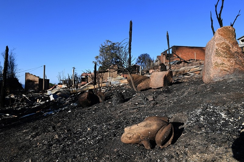 ome of the more than 70 houses and businesses destroyed by a bushfire in the coastal town of Tathra, New South Wales, Australia, March 19,  2018 (EPA Photo)