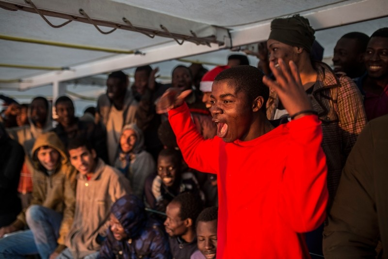 Migrants stay at the deck of the Spanish NGO Proactiva Open Arms rescue vessel, after being rescued in the central Mediterranean sea Dec. 21, 2018, before disembarking in the port of Crinavis in Algeciras, Spain, Friday, Dec. 28, 2018. (AP Photo)