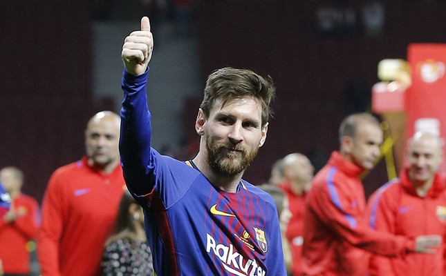 Barcelona's Lionel Messi celebrates during an award ceremony after defeating Sevilla 5-0 in the Copa del Rey final soccer match at the Wanda Metropolitano stadium in Madrid, Spain (AP Photo)