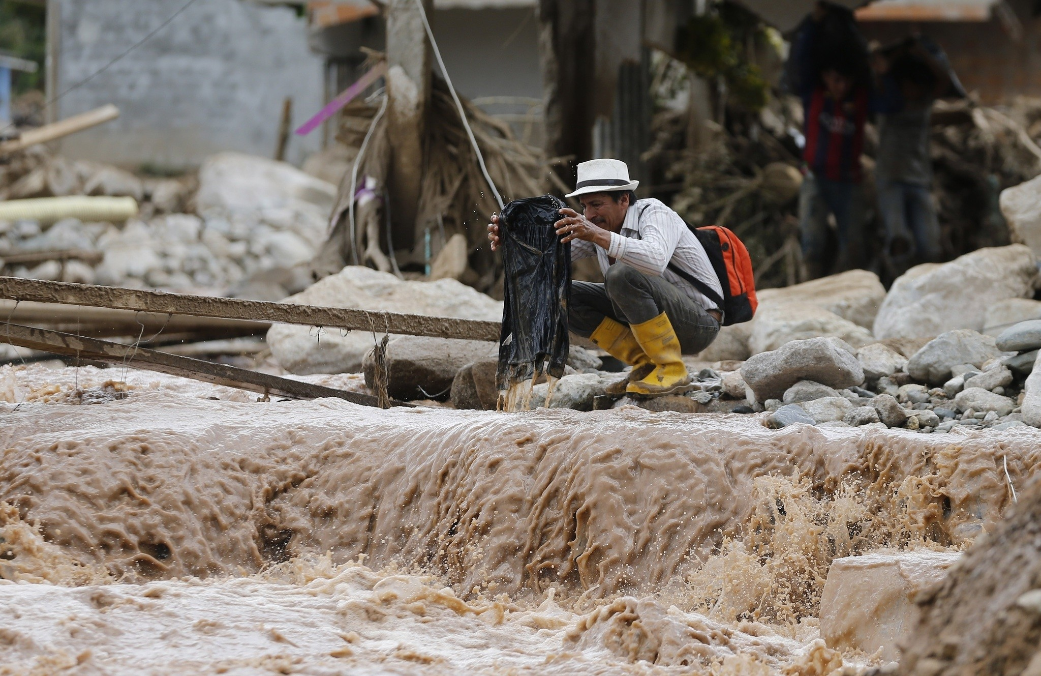 A man holds recovered from the mud in Mocoa, Colombia, Sunday, April 2, 2017. (AP Photo)