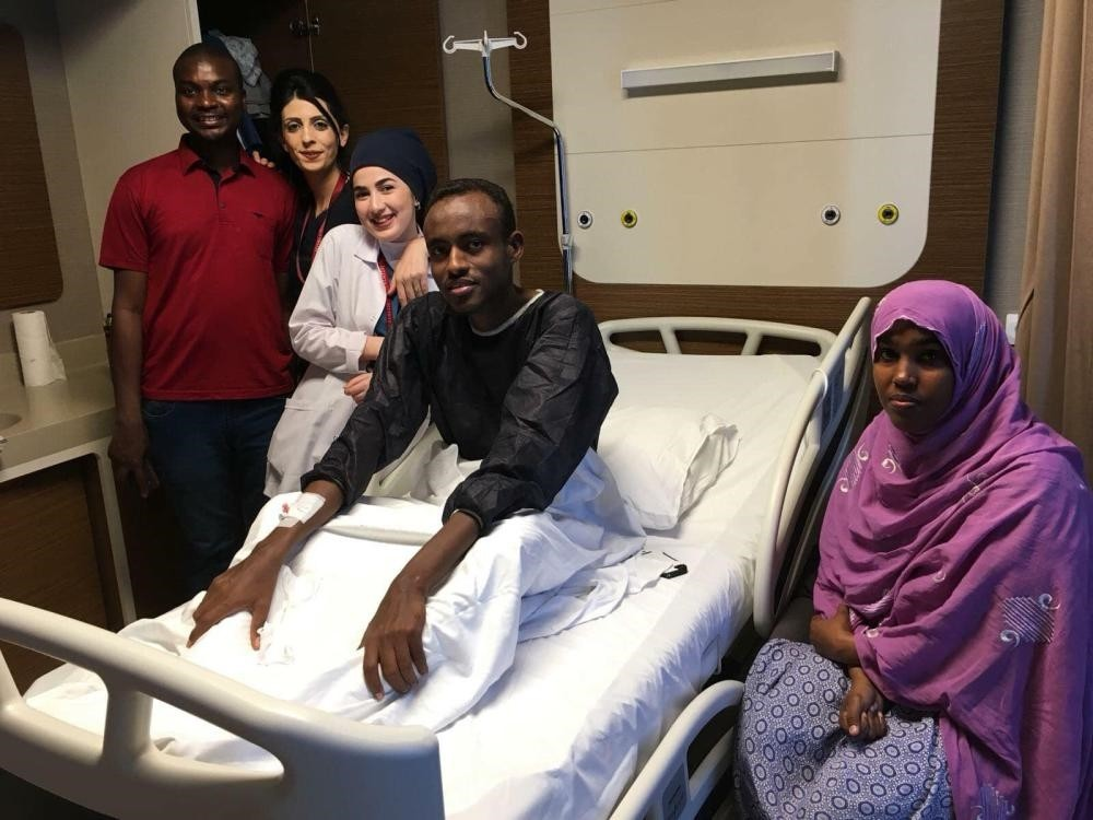 Djiboutian national Elmi Omar Abdullahi poses with his family and healthcare staff in a hospital room in Istanbul on Jan. 17, 2019 after a kidney transplant.