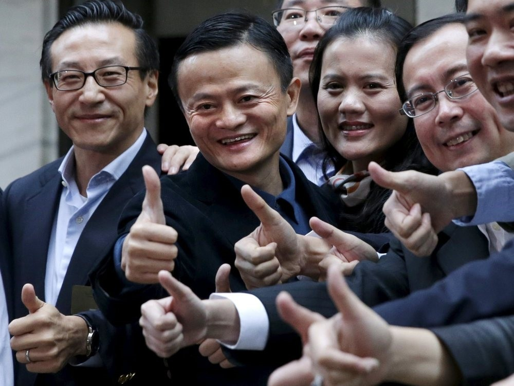 Alibaba Group founder Jack Ma (2nd L) poses as he arrives at the New York Stock Exchange for his company's initial public offering in New York, Sept. 19, 2014.