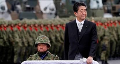 Abe renews pledge to boost Japan's military power