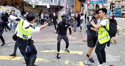 Violence erupts after police shoot Hong Kong protester