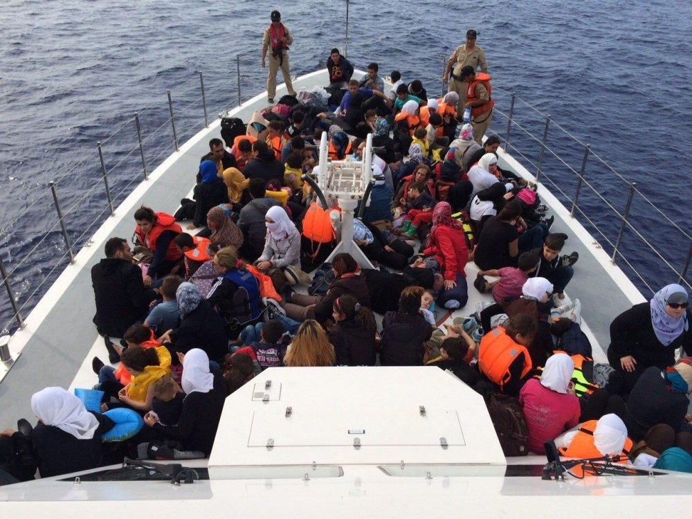 Syrian migrants aboard a Turkish Coast Guard boat after they were intercepted off the shores of Finike in southern Turkey.
