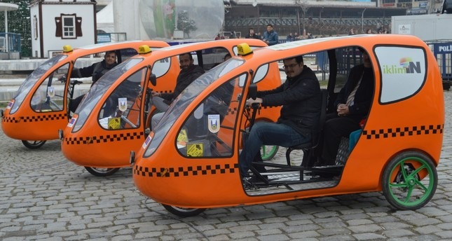 Environment friendly cab bikes, similar to iconic tuk tuk, haul commuters free of charge.
