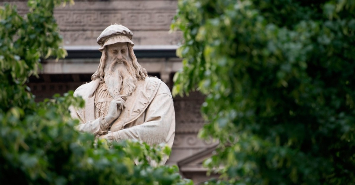 A picture taken in center Milan on May 3, 2019 shows the details of a statue of Italian Renaissance genius Leonardo da Vinci done by Italian sculpture Pietro Magni. (AP Photo)