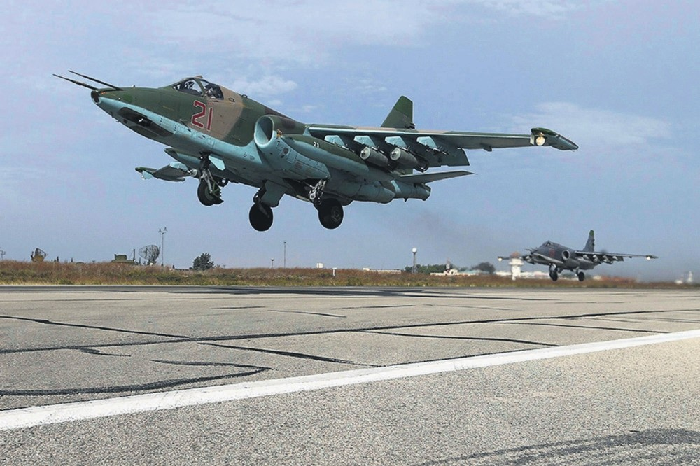 Su-25 fighter jets take off from the Hmeymim Air Base near Latakia, Syria.
