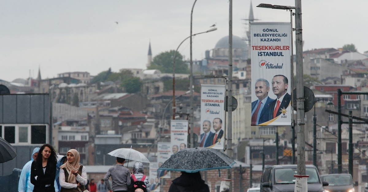 An election banner with the pictures of President Recep Tayyip Erdou011fan and AK Party mayoral candidate Binali Yu0131ldu0131ru0131m seen over the Galata Bridge in Istanbul, May 7, 2019.