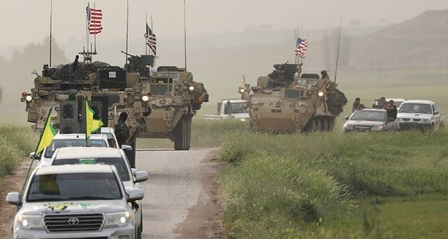 Terrorists from the People's Protection Units (YPG) head a convoy of U.S military vehicles in the town of Darbasiya next to the Turkish border, Syria April 28, 2017. (Reuters Photo)