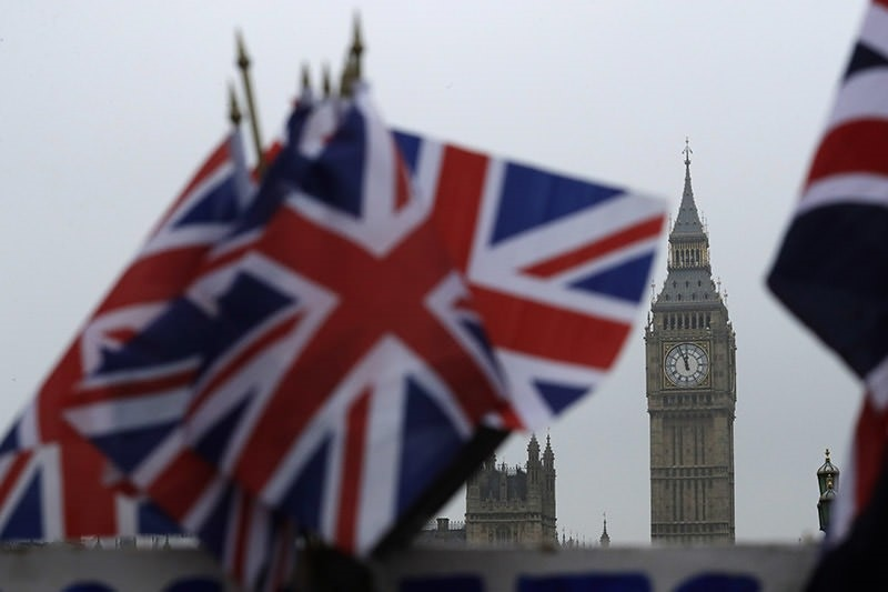 U.K. flags displayed on a tourist stall, backdropped by the Houses of Parliament and Elizabeth Tower containing the bell know as Big Ben, in London on Feb. 8, 2017. (AP Photo)