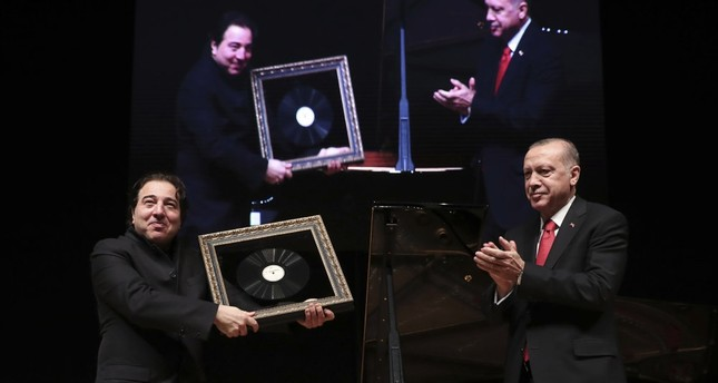 President Erdoğan applauds Fazıl Say (L), world-renowned Turkish pianist and composer, after his classical music concert, Ankara, Jan. 18.