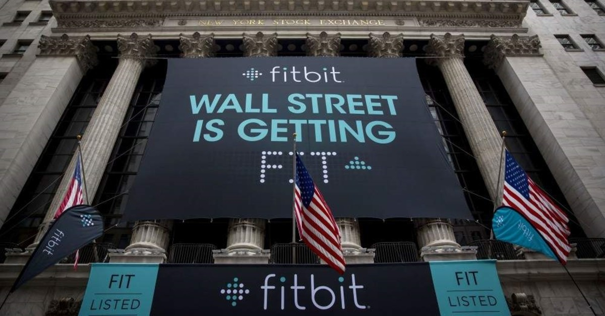 In this file photo taken on June 18, 2015, Fitbit banners decorate the exterior of the New York Stock Exchange during the IPO debut of the company in New York City. (AFP Photo)