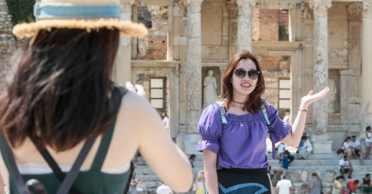 A tourist poses at the ancient site of Ephesus in western Turkey's Izmir province. (AA Photo)