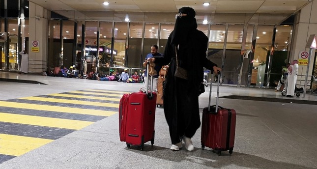A Saudi woman walks with her luggage as she arrives at King Fahd International Airport in Dammam, Saudi Arabia, August 5, 2019. Reuters Photo