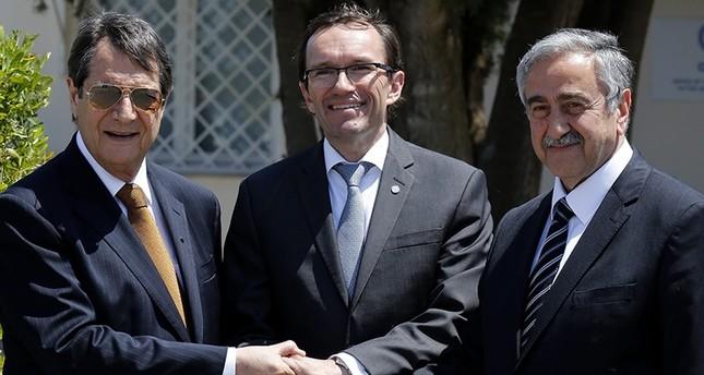 Greek Cypriot leader Nicos Anastasiades(L), Turkish Cypriot leader Mustafa Akıncı(R), and UN envoy Espen Barth shake hands May 15, 2015. (AP Photo)