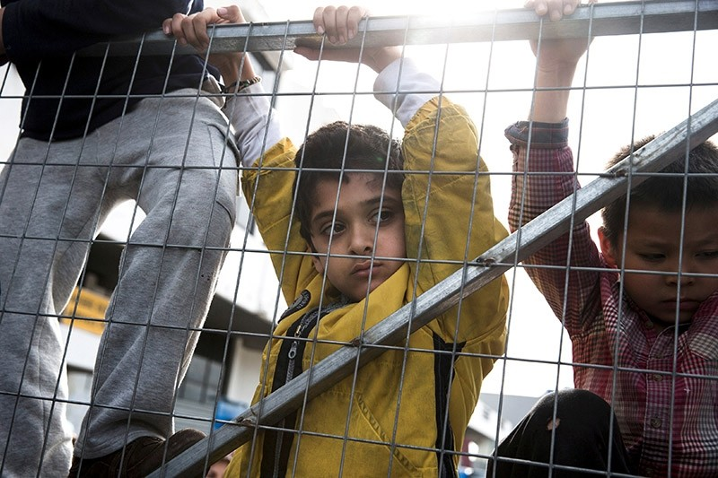 Children climb at the entrance of the refugee camp at the disused Hellenikon airport, blocked by protesting refugees and migrants, most of them Afghans, in Athens, Greece, February 6, 2017. (Reuters Photo)