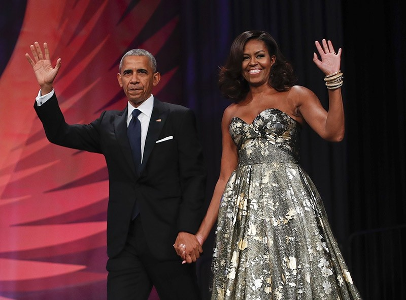 This Sept. 17, 2016 file photo shows President Barack Obama and first lady Michelle Obama at the Congressional Black Caucus Foundation's 46th Annual Legislative Conference Phoenix Awards Dinner in Washington. (AP Photo)