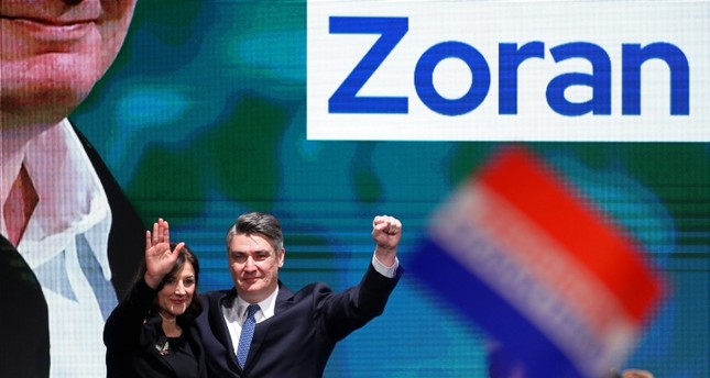 Presidential candidate Zoran Milanovic and his wife Sanja Music Milanovic spear on stage at his campaign headquarters after the presidential election in Zagreb, Croatia December 22, 2019. Reuters Photo