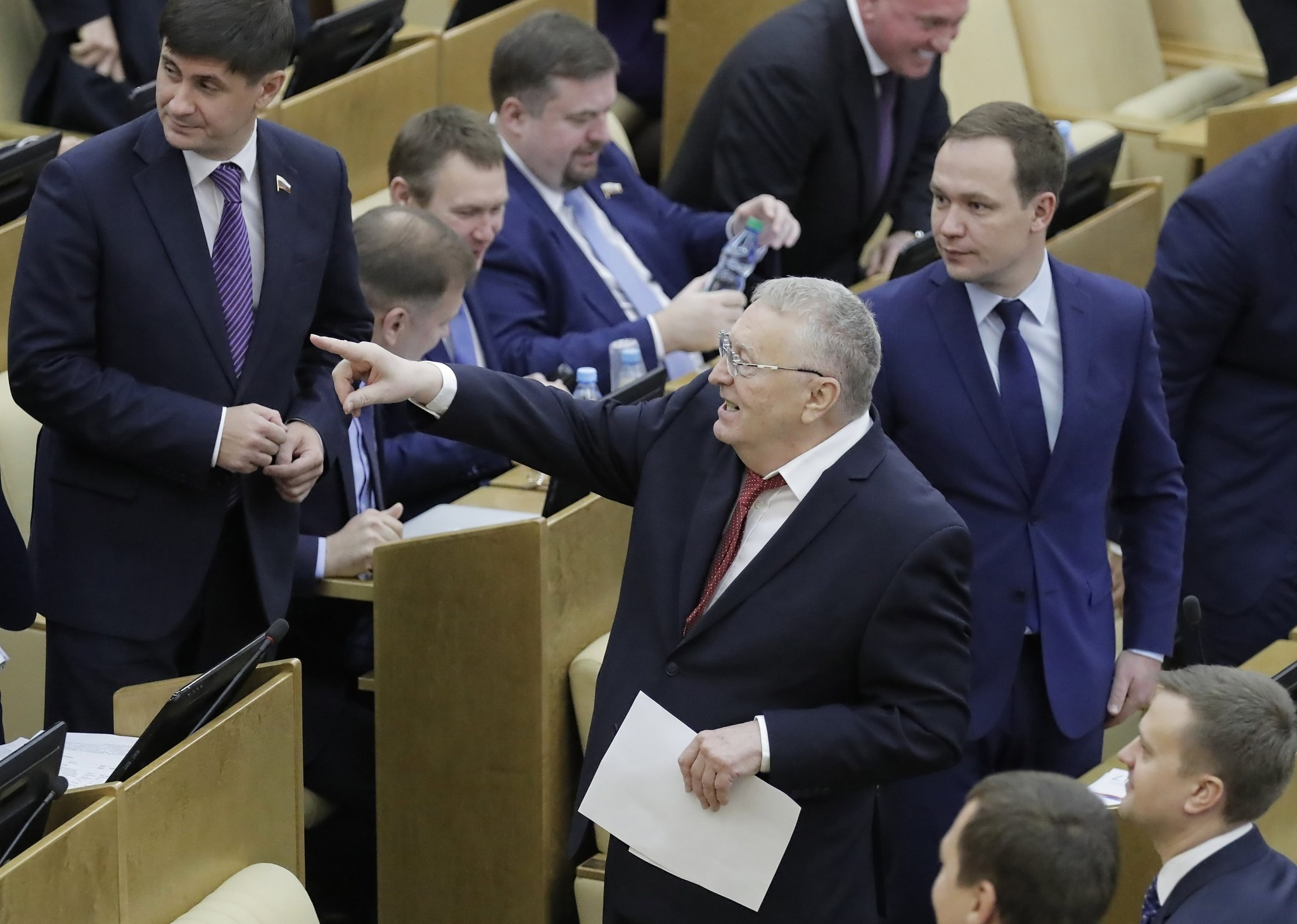 The Russian Liberal Democratic Party (LDPR) head and parliamentary LDPR fraction's leader Vladimir Zhirinovsky (front) gestures prior to a plenary session considering the draft of amendments to the Russia's Law on Media on Nov. 15, 2017 (EPA Photo)