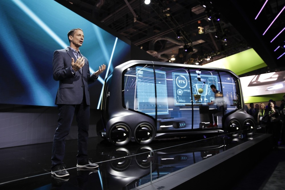 John Scumniotales of Amazon Alexa Automotive stands next to the Toyota e-Pallet concept while speaking at a news conference at CES International in Las Vegas.